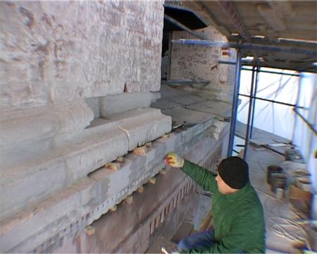 The damaged white-stone blocks are replaced by new pieces